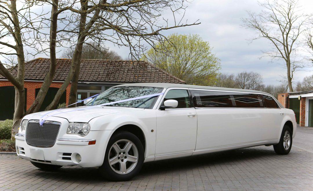 White Chrysler Limousine Abbey Weddings
